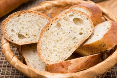 Pieces of baguette with herbs in a basket, close-up Stock Image