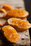 Pieces of baguette with orange marmalade Royalty Free Stock Photo