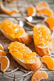 Pieces of baguette with orange marmalade Stock Images