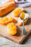 Pieces of baguette with orange marmalade Stock Photography