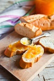Pieces of baguette with orange marmalade Stock Image