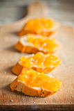 Pieces of baguette with orange marmalade Royalty Free Stock Photography