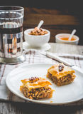Pieces of baklava with honey and nuts, rustic,  Turkish dessert Stock Image