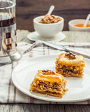 Pieces of baklava with honey and nuts, rustic,  Turkish dessert Royalty Free Stock Image