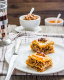 Pieces of baklava with honey and nuts, rustic,  Turkish dessert Royalty Free Stock Photos