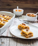 Pieces of baklava with honey and nuts, rustic,  Turkish dessert Royalty Free Stock Photo