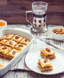 Pieces of baklava with honey and nuts, rustic,  Turkish dessert Stock Images