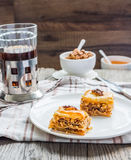 Pieces of baklava with honey and nuts, rustic,  Turkish dessert Royalty Free Stock Images