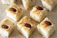 Pieces Basbousa namoora traditional arabic semolina cake. With almond nut and syrup, Top view. Selective focus Stock Photos