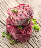 Pieces of beef tenderloin on the wood. Stock Photography