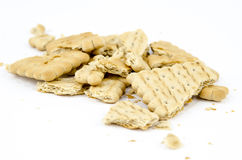 Pieces of biscuits with crumbs Royalty Free Stock Images