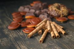Pieces of bittersweet dark chocolate spread out on a wooden back. Ground stock photography