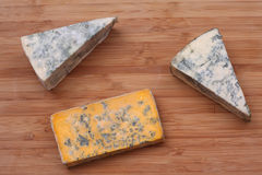 Pieces of blue cheese and Blacksticks Blue Cheese. Close-up Royalty Free Stock Images