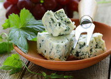 Pieces of blue cheese with red grapes Royalty Free Stock Photography