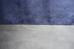 Pieces of blue and grey suede sewn together horizontally. Pieces of blue and grey artificial suede sewn together horizontally Stock Photo