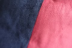 Pieces of blue and red artificial suede sewn together. Pieces of dark blue and red artificial suede sewn together Royalty Free Stock Image
