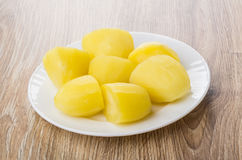 Pieces of boiled potatoes in white plate on table Royalty Free Stock Photo
