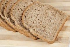 Pieces of bread. Pieces of grain bread on a board royalty free stock photos