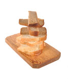 Pieces of bread  on a wooden board Stock Photography