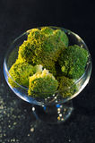 Pieces of broccoli in an elegant cup Royalty Free Stock Photo