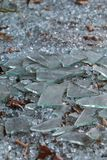 Pieces Of Broken Glass Lie On Ground At Vandalized Business. Pieces of broken glass lie on ground at vandalized building that has gone out of business Stock Photo