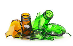 Pieces of broken glass over white background. Recycling stock image