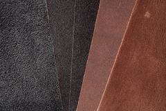 Pieces of brown and black leather. Nubuck Royalty Free Stock Photo