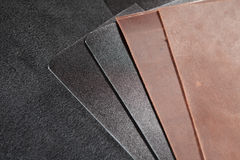 Pieces of brown and black leather. Nubuck Royalty Free Stock Images