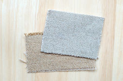 Pieces of brown and gray canvas on wood. Royalty Free Stock Images