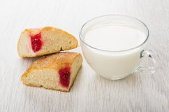 Pieces of bun with jam and cup of milk Stock Images