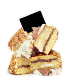 Pieces of cake and blank blackboard label Stock Photography