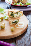 Pieces of cake with egg and spinach on the board Royalty Free Stock Photos
