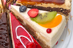 Pieces of the cake with fresh fruit Stock Photos