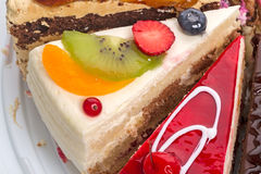 Pieces of the cake with fresh fruit Royalty Free Stock Photography