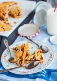 Pieces of cake on a shortcrust pastry with orange jam Royalty Free Stock Photo