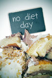 Pieces of cake and text no diet day on a signboard Royalty Free Stock Photo