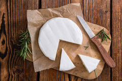 Pieces of Camembert. (detailed close-up shot) on wooden background Stock Photos