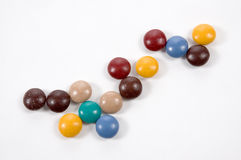Pieces of Cancy. Small round buttonlike candies on a white background Royalty Free Stock Photos
