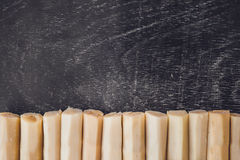 Pieces of cane sugar on the old wooden background. Sugar concept Royalty Free Stock Photos