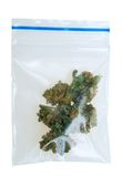 Pieces of Cannabis in a plastic bag. Cannabis in a plastic bag , photo taken with a macro lens, isolated on a white background Royalty Free Stock Photos