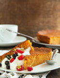 Pieces of carrot cake with whipped cream and berry Stock Photos