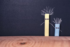 Pieces of chalk with eyes, concept friendship. Two pieces of chalk with eyes, concept friendship Royalty Free Stock Photography