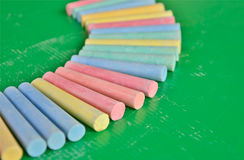 Pieces of chalk on green Stock Photography