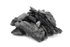 Pieces of  charcoal on white background Stock Photo