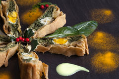 Pieces Of Chard Pie Decorated With Holly Stock Photos