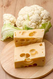 Pieces of cheese and cauliflower Royalty Free Stock Images
