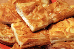 Pieces of cheese pie. Pieces of flaky cheese pie close up Stock Image