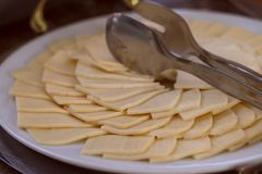 Pieces of cheese on a plate. stock photography