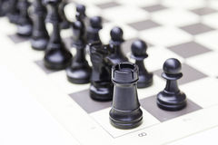 Pieces in a chess board Stock Photo