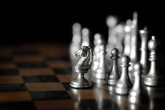 Pieces on chess board for playing game and strategy royalty free stock photo